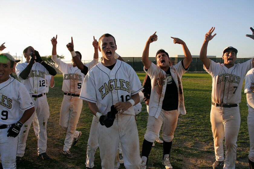 The Olympian baseball team (shown celebrating a playoff win last season) won't have the opportunity this season to participate in the playoffs.