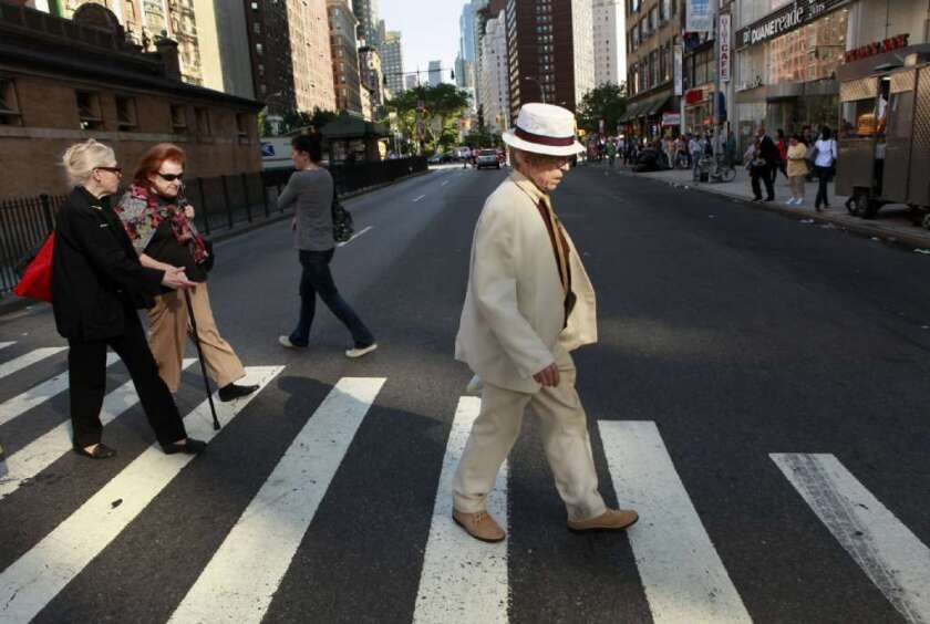 Older people crossing a street