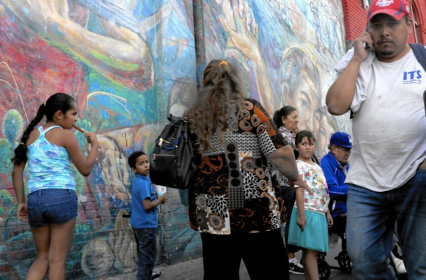 Latinos made up 39% of California's population last year, but a new report says just 10% of county supervisors and 15% of city council members are Latino. Above, a bus stop in Boyle Heights.