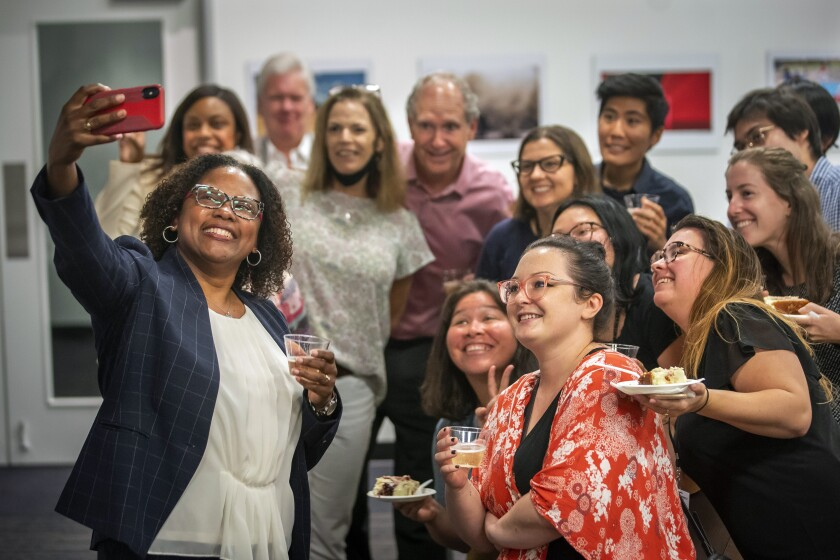 Maria Reeve celebrates as she is named the executive editor of the Houston Chronicle, Tuesday, July 20, 2021, at the Chronicle's Houston office. Reeve has served as a Pulitzer Prize juror and has been active in the National Association of Black Journalists. The South Carolina native becomes the first person of color named as editor of the 120-year-old Houston daily. (Mark Mulligan/Houston Chronicle via AP)