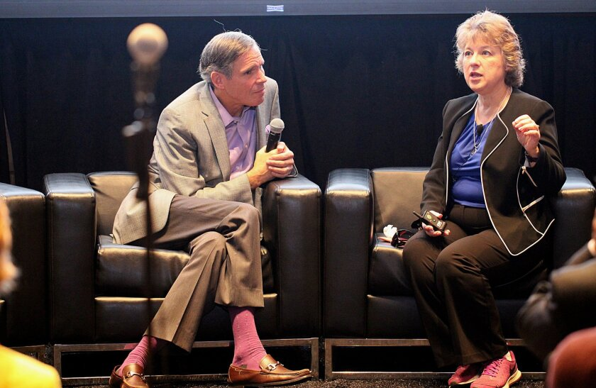 Dr. Eric Topol, left, listens as Dardie Robinson describes her participation in the Molecular Autopsy Study from Scripps Translational Science Institute.