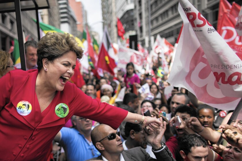 Brazil's President Dilma Rousseff, who is running for reelection, greets supporters at a rally in Porto Alegre.