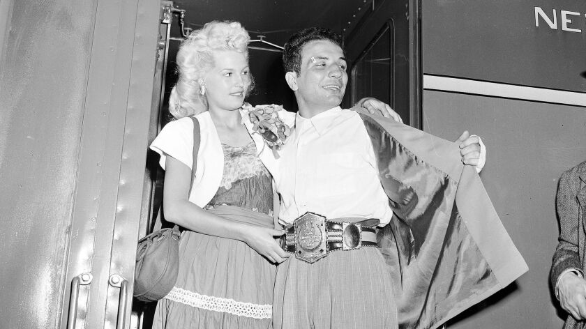 The newly crowned World Middleweight Boxing Champion Jake LaMotta, accompanied by his wife Vicky, ar