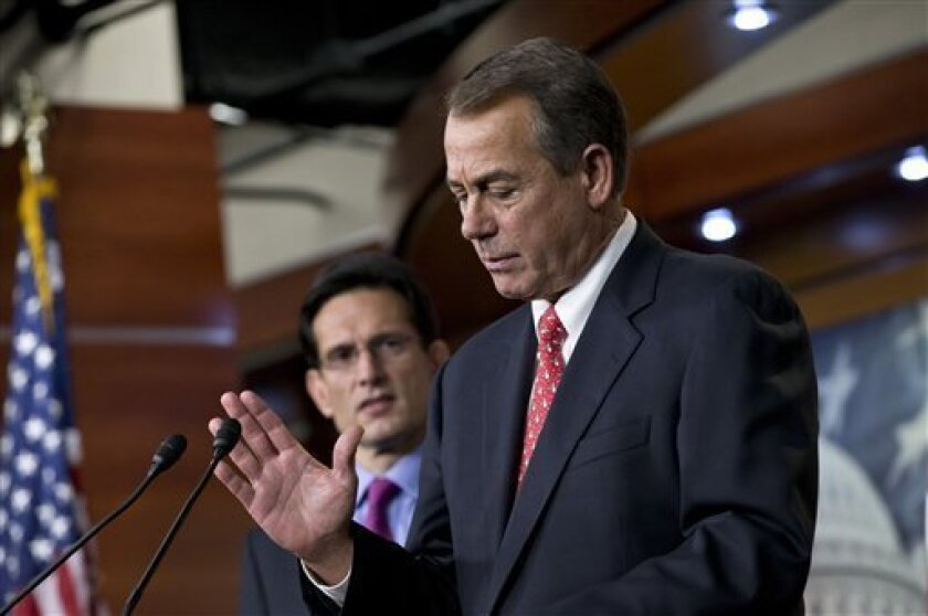 FILE - In this Friday, Dec. 21, 2012, file photo, speaker of the House John Boehner, R-Ohio, joined by House Majority Leader Eric Cantor, R-Va., left, speaks to reporters about the fiscal cliff negotiations at the Capitol in Washington. Lawmakers probably could enact a compromise quickly and easily