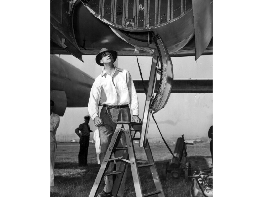 July 7, 1946: Howard Hughes steps up to board the XF-11 aircraft at Culver City Airport. The aircraf