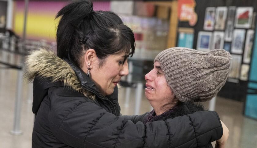 SEATTLE, WASH. -- WEDNESDAY, FEBRUARY 6, 2019: Nadia Mousavi, 28, left, comforts her friend Saltana