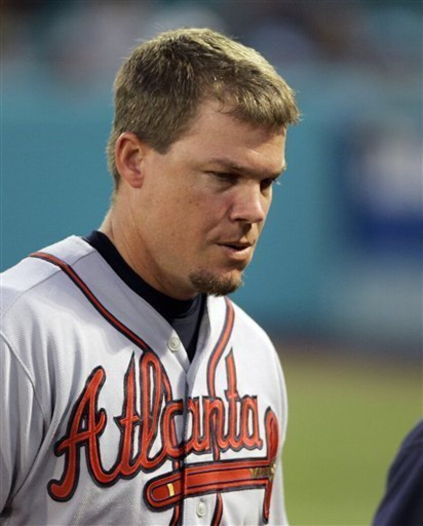 Atlanta Braves' Chipper Jones heads to the dugout after injuring his left leg while trying to run out a groundout against the Florida Marlins in the fourth inning of a baseball game in Miami, Wednesday, July 23, 2008. The Braves won 9-4. (AP Photo/Alan Diaz)
