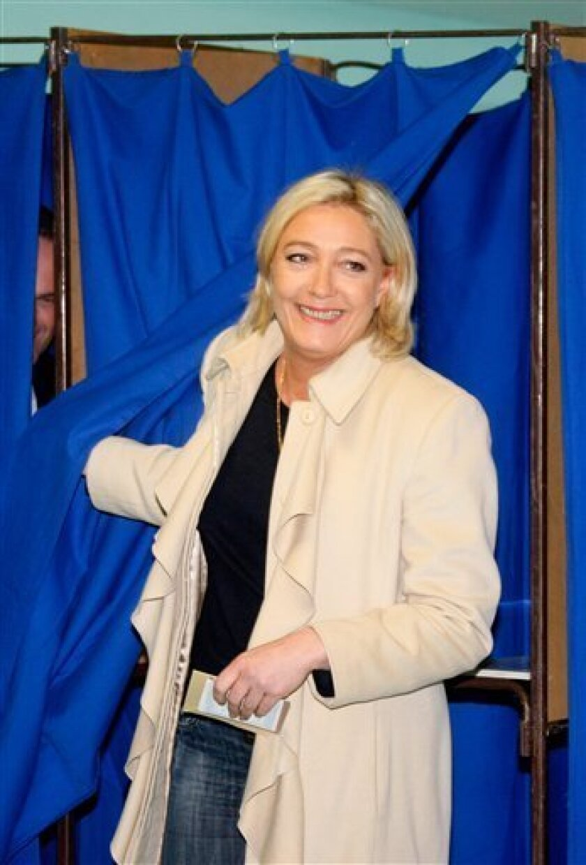 Marine Le Pen, France's far-right leader National Front party, exits a polling booth after casting her vote for the second round of local elections, in Henin-Beaumont, France, Sunday March 27, 2011. (AP Photo/Michel Spingler)
