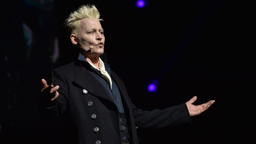 "Johnny Depp, in character as Grindelwald, surprises fans at the Warner Bros. theatrical panel for ""Fantastic Beasts: The Crimes of Grindelwald"" during Comic-Con on July 21, 2018, in San Diego."