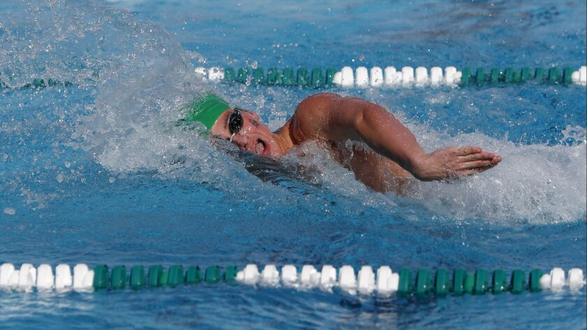 Costa Mesa High's Aidan Blair competes against Estancia in the boys' 100-yard freestyle race during