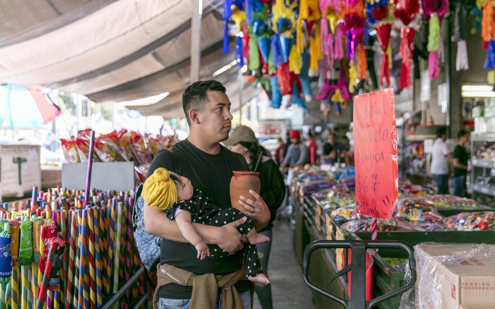 Francisco Martinez and his 4-month-old daughter, Andrea, in the Piñata District in downtown Los Angeles.