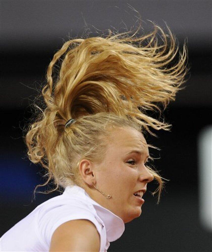 The hair of Denmark's Caroline Wozniacki flies  during her second round match against Czech's Lucie Safarova at the Porsche Tennis Grand Prix in Stuttgart, Germany, Thursday, April 29, 2010. Wozniacki lost 4-6, 4-6. (AP Photo/ apn/Daniel Maurer)
