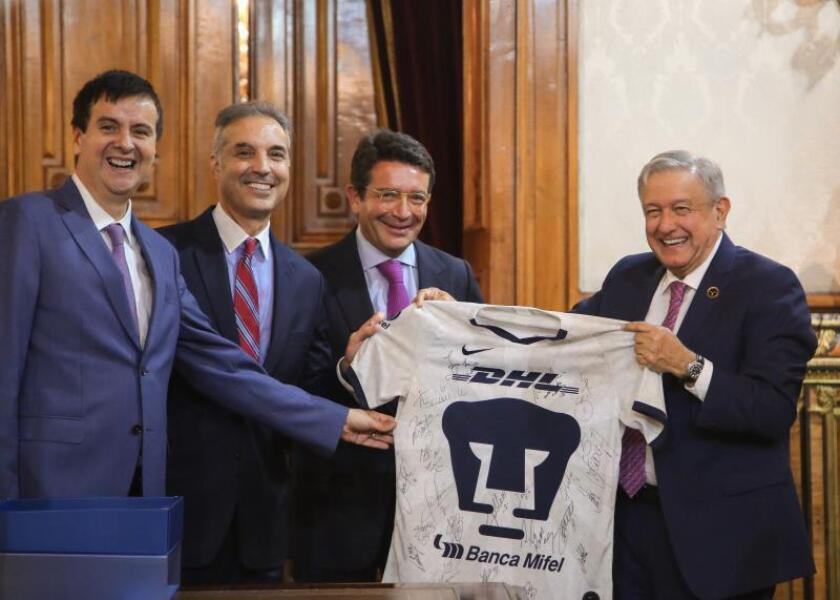 López Obrador anuncia inversión de 300 millones de dólares de DHL en México