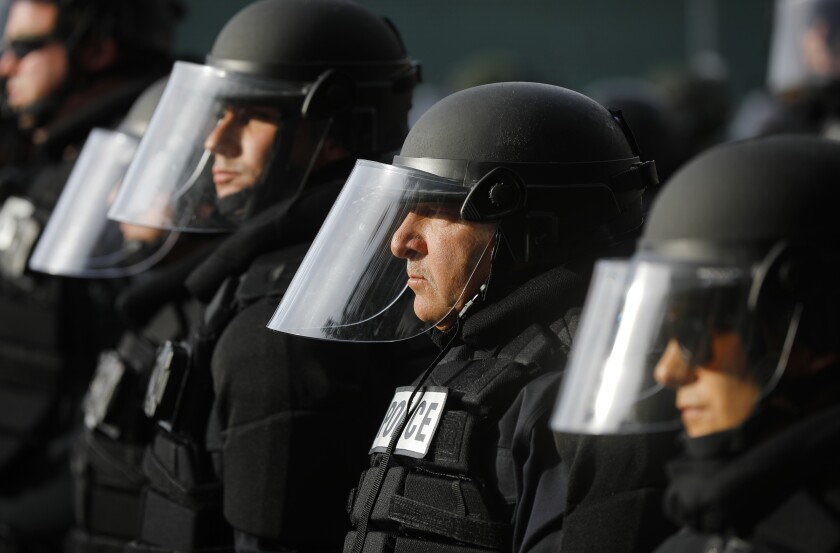San Diego police look on during a youth-led protest near San Diego Police headquarters on June 1, 2020.