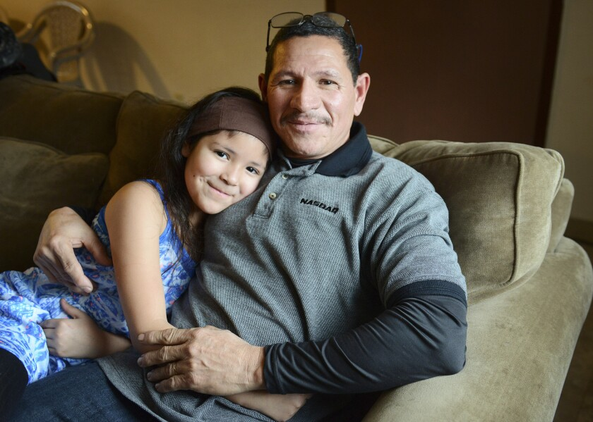 "Emiliano Cabrera, 53, is from Honduras and his daughter Emily Cabrera Vindel, 8, was born in North Carolina. Cabrera came to the United States in 2000 and said having papers would bring him ""internal peace."""