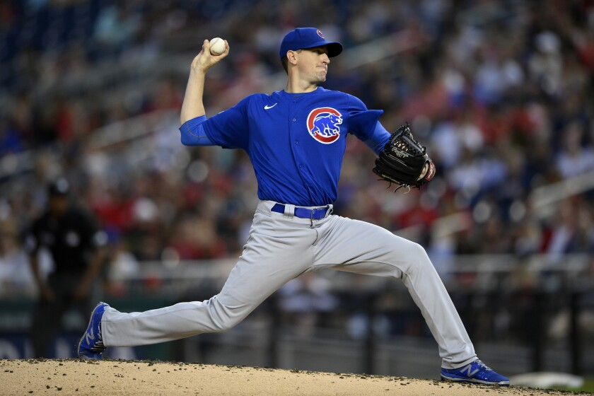 Chicago Cubs starting pitcher Kyle Hendricks delivers during the third inning of a baseball game against the Washington Nationals, Saturday, July 31, 2021, in Washington. (AP Photo/Nick Wass)