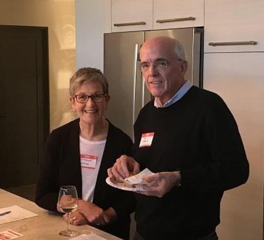 La Jolla Newscomers Club members Stephanie Shapiro and Tim Morris attend a wine social.