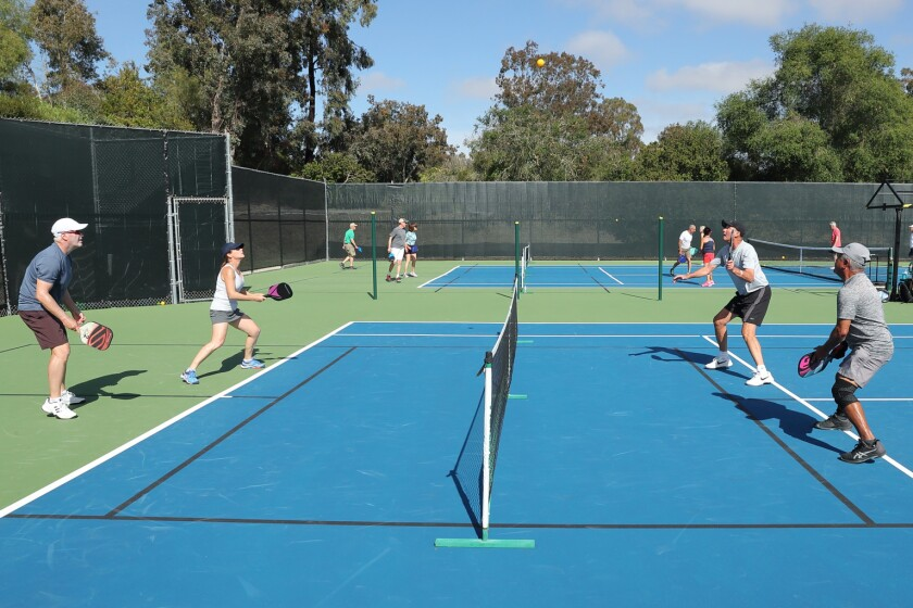 Jim Stuart, Candace Stuart, Jim Simpson and Rich Mejia play pickleball at the RSF Tennis Club.