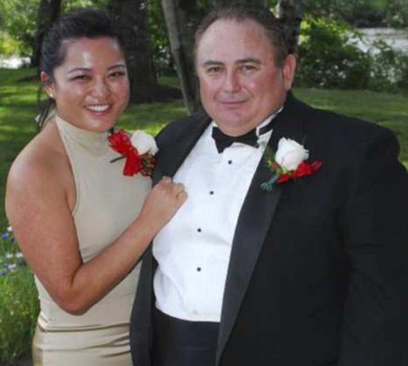 Robert Rizzo, Bell's former city manager, and his wife, Eugenia, in 2007. A Washington neighbor says family is important to Rizzo.