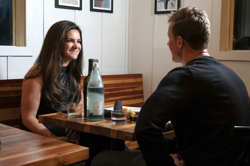Carina and David start up a conversation as they wait to be served at Valentina in Encinitas.