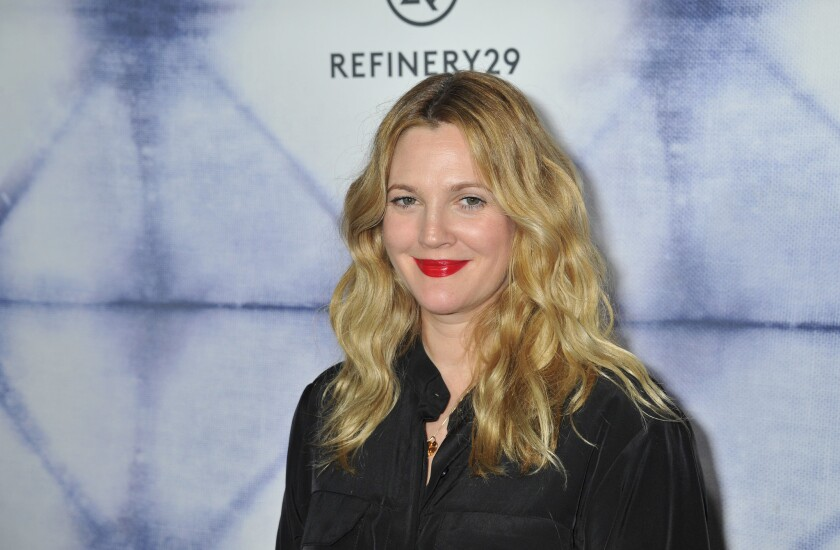 Drew Barrymore arrives at the Refinery29 Holiday Party at Sunset Towers in Los Angeles on Dec. 10