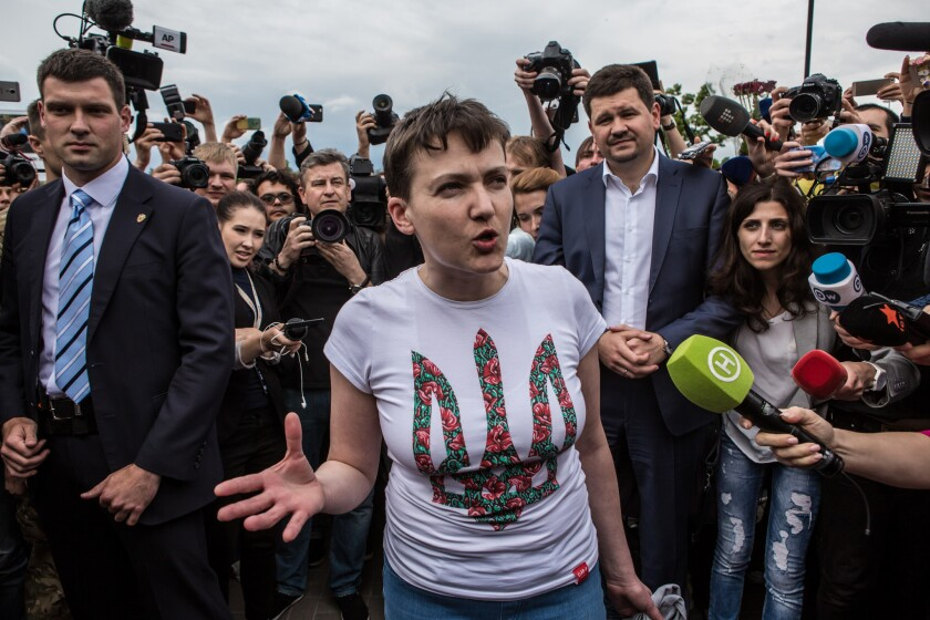 Ukrainian military pilot Nadiya Savchenko is surrounded by media upon her arrival Wednesday in Boryspil, Ukraine.