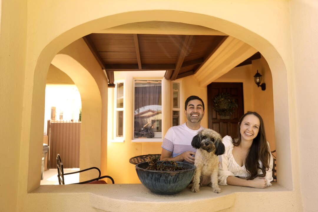 Devin Sunseri, his then fiancee, Katie Scardino, and their dog Tallulah on the porch of their home.