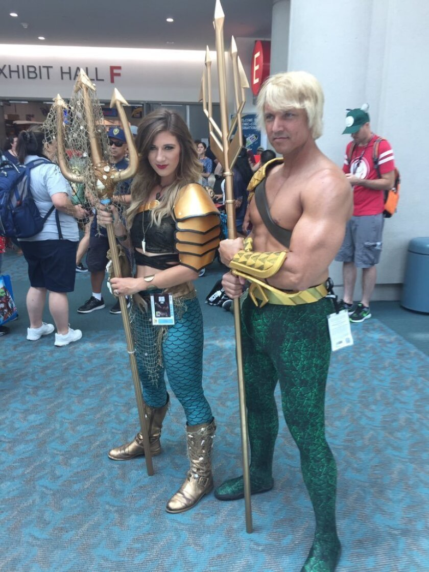 Comic-Con cosplayers Alex Drachnik, 23, of San Diego and Ben Dickinson, 41, of Arizona came as Aqua-ma'm and Aquaman.