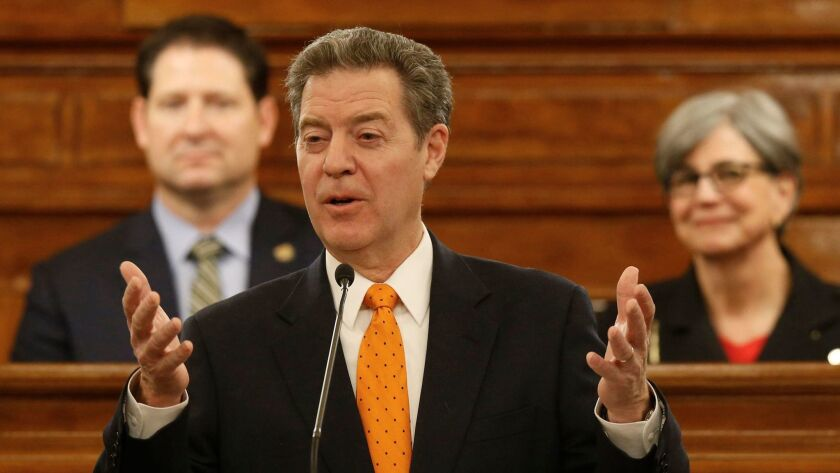 No longer flying high: Kansas Gov. Sam Brownback, seen here delivering his State of the State address in January, was rebuked by the Legislature with a veto override on Tuesday.