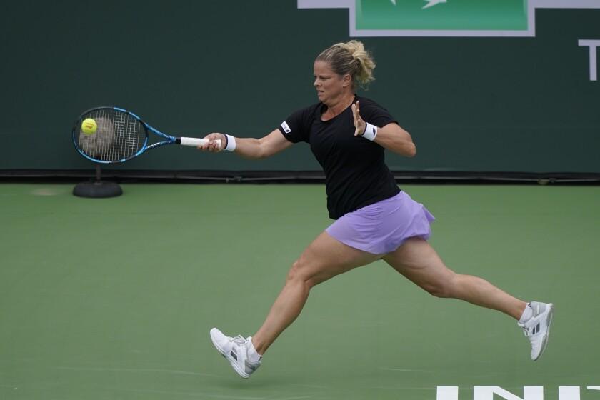 Kim Clijsters, of Belgium, returns a shot to Katerina Siniakova, of the Czech Republic, at the BNP Paribas Open tennis tournament Thursday, Oct. 7, 2021, in Indian Wells, Calif. (AP Photo/Mark J. Terrill)