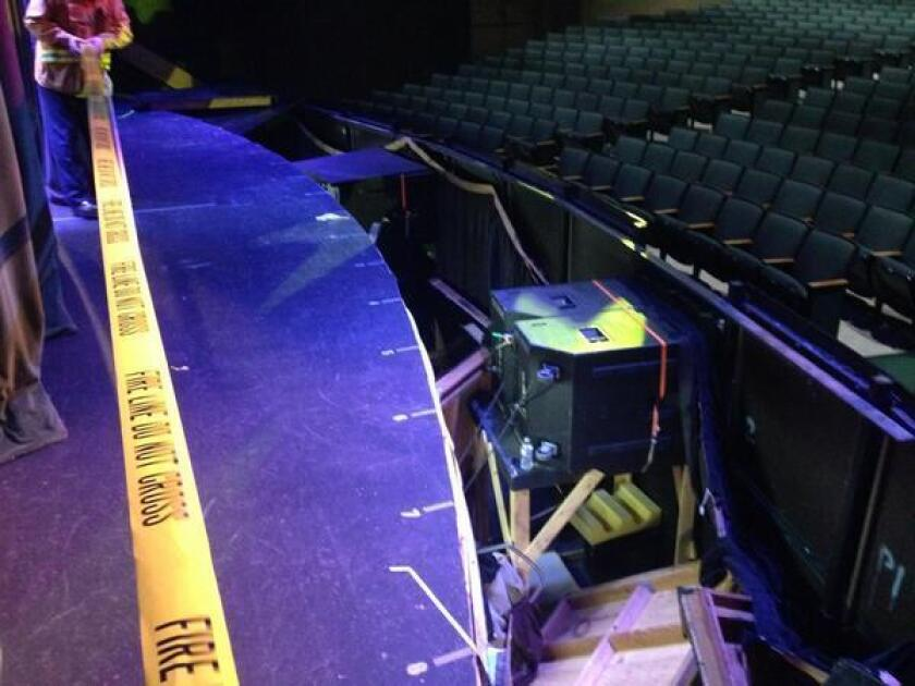 A section of the collapsed Servite High School auditorium stage is cordoned off.