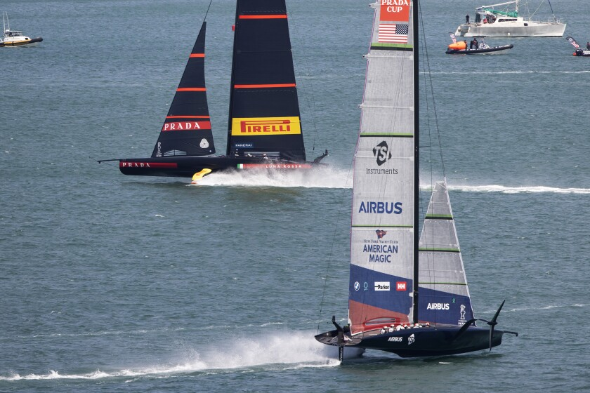 FILE - In this Jan. 29, 2021, file photo, Italy's Luna Rossa, left, leads American Magic during the America's Cup challenger series on Auckland's Waitemate Harbour, New Zealand. The sting of being the first team eliminated from the 36th America's Cup is going to be with the New York Yacht Club's American Magic for quite some time. American Magic has had a week to ponder the end of its campaign, which was hastened when its yacht, Patriot, capsized and nearly sank during a race in the challenger round-robins on Jan. 17 during a race against Italy's Luna Rose Prada Pirelli Team. (Brett Phibbs/NZ Herald via AP, File)