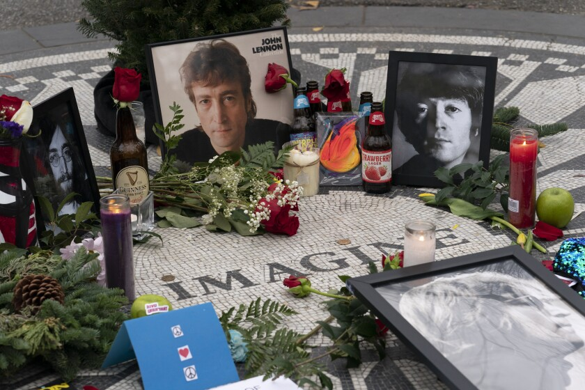 Photos, flowers and candles left at Strawberry Fields in New York's Central Park to remember John Lennon