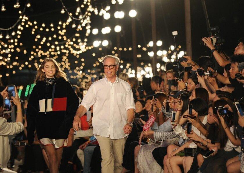 Gigi Hadid and Tommy Hilfiger walk the runway after the Tommy Hilfiger Fall 2016 collection and the Tommy x Gigi capsule were shown at Fashion Week in New York on Sept. 9.