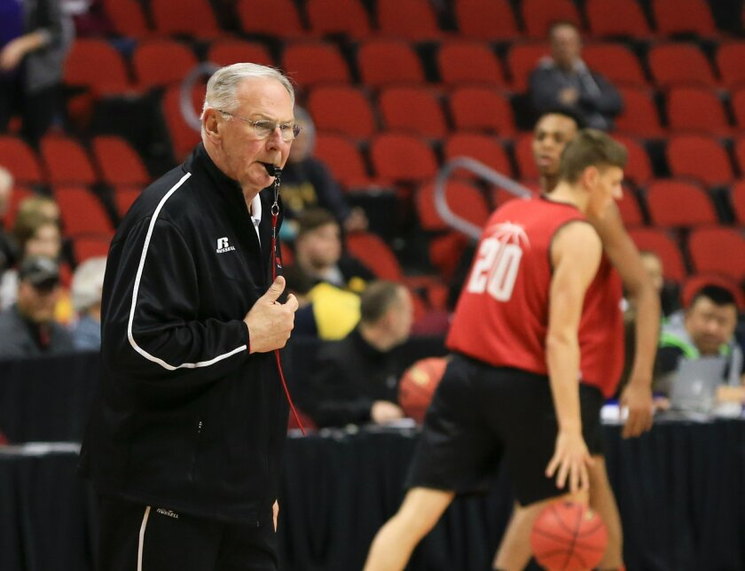 Austin Peay coach Dave Loos follows his players during practice for a first-round men's college basketball game in the NCAA Tournament in Des Moines, Iowa, Wednesday, March 16, 2016. Austin Peay will play Kansas on Thursday. (AP Photo/Nati Harnik)