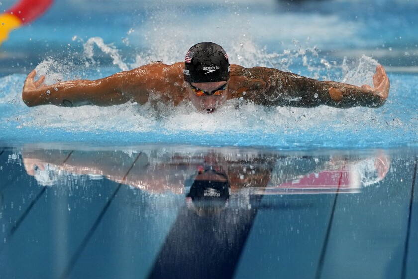 Caeleb Dressel broke his own world record in the 100-meter butterfly on a day she swam two other races.