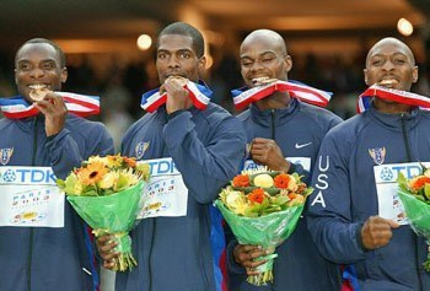 Tyree Washington (far right) and the 4x400-meter relay team were stripped of their gold medals won at the 2003 World Championships when Calvin Harrison (second from right) failed a drug test. (File photo / Getty Images)