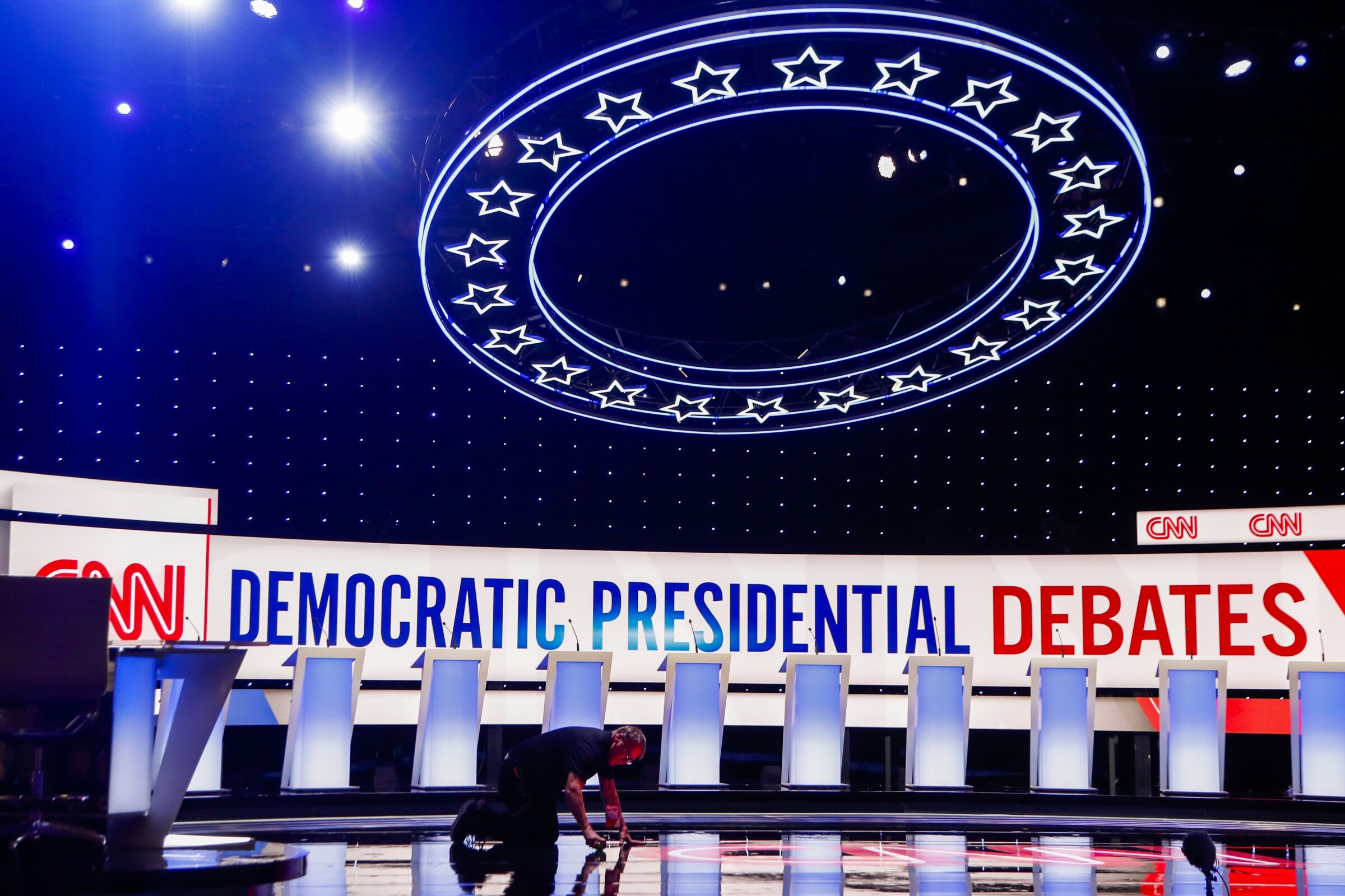A worker gets the stage ready for the Democratic primary debate hosted by CNN at the Fox Theatre in Detroit on July 30.