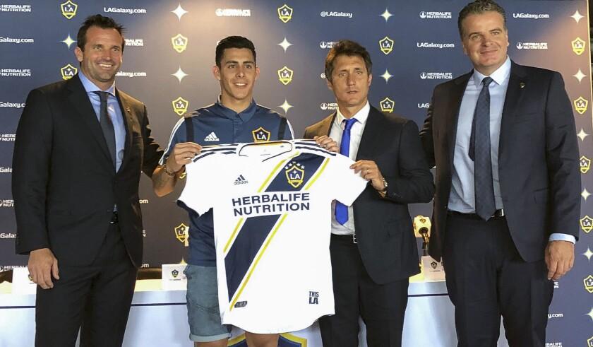 Galaxy executives introduce Cristian Pavon to the media Thursday.