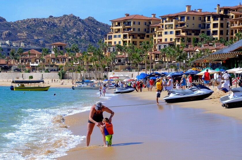 People on the beach in Cabo San Lucas