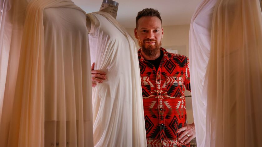 Bradon McDonald stands among dress forms for ongoing projects in his Los Angeles home studio. His work for Jessica Lang Dance can be seen Friday through Sunday at the Music Center.