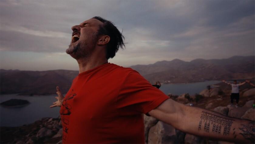 """David Arquette screams in triumph in a scene from """"You Cannot Kill David Arquette."""""""
