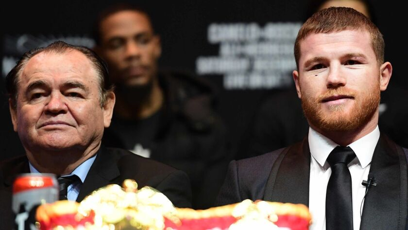 Canelo Alvarez is joined by his manager, Chepo Reynoso, during a news conference at Madison Square Garden.