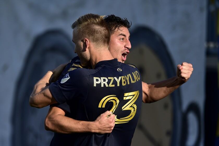 Philadelphia Union's Alejandro Bedoya celebrates with Kacper Przybylko after a goal during the second half of an MLS soccer match against the Columbus Crew, Sunday, Oct. 3, 2021, in Chester, Pa. (AP Photo/Derik Hamilton)