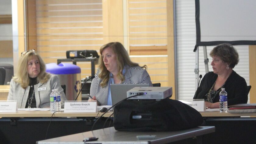 Airport Planning & Noise Mitigation acting director Angela Jamison, program manager Sjohnna Knack and meeting facilitator Heidi Gantwerk at the Feb. 15 Airport Noise Advisory Committee meeting.