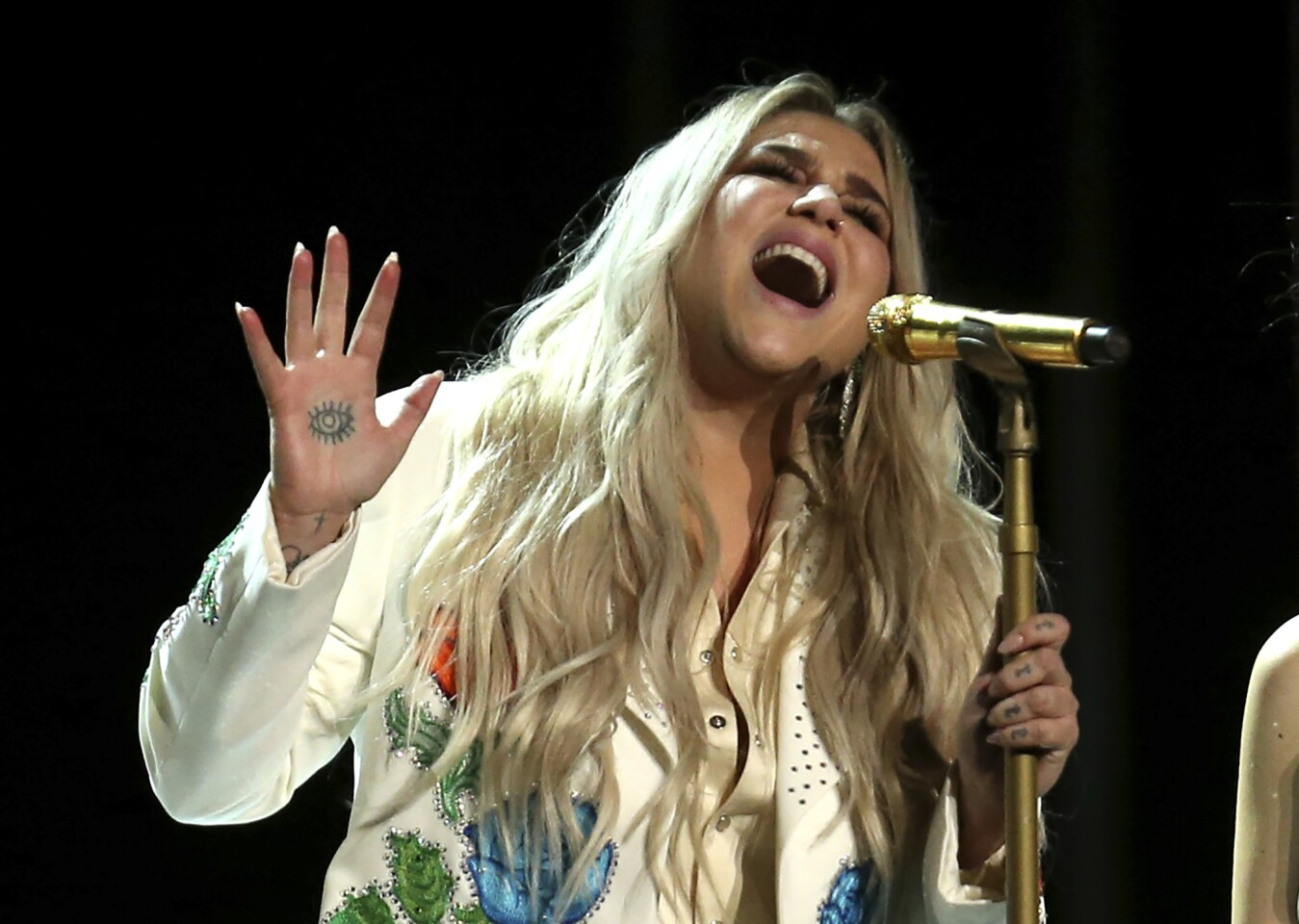 Kesha performs at the 60th Grammy Awards at Madison Square Garden in New York on Sunday.