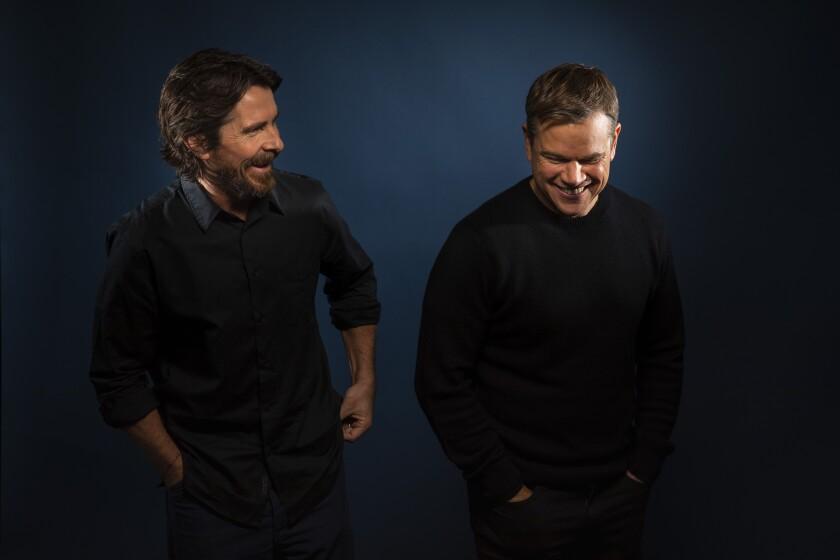 Christian Bale, left, and Matt Damon share a moment of levity.
