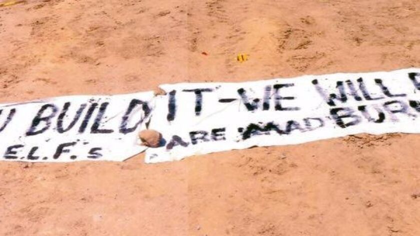 A message written on 12-foot bedsheets left at the 2003 ELF arson fire in University City.