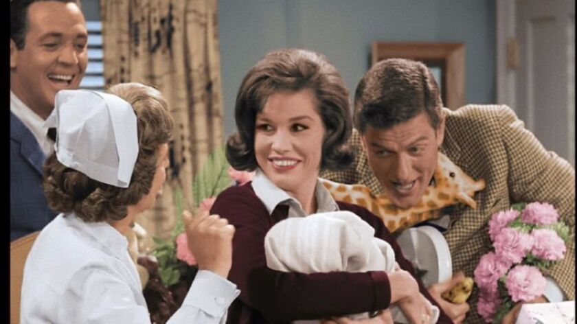 "Dick Van Dyke, right, and Mary Tyler Moore, center in a newly colorized episode of ""The Dick Van Dyke Show."""