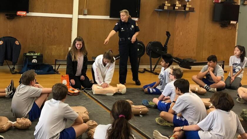 Seventh-graders participate in a CPR training class at Muirlands Middle School in La Jolla with instructor Maureen O'Connor of San Diego Project Heartbeat.
